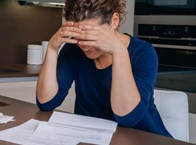 woman struggling with documents